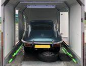 Jaguar E-type in covered trailer
