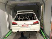 Peugeot 306 rally car in enclosed trailer