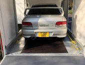 Japanese import enclosed car transport