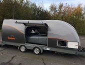 Classic Jaguar in enclosed trailer